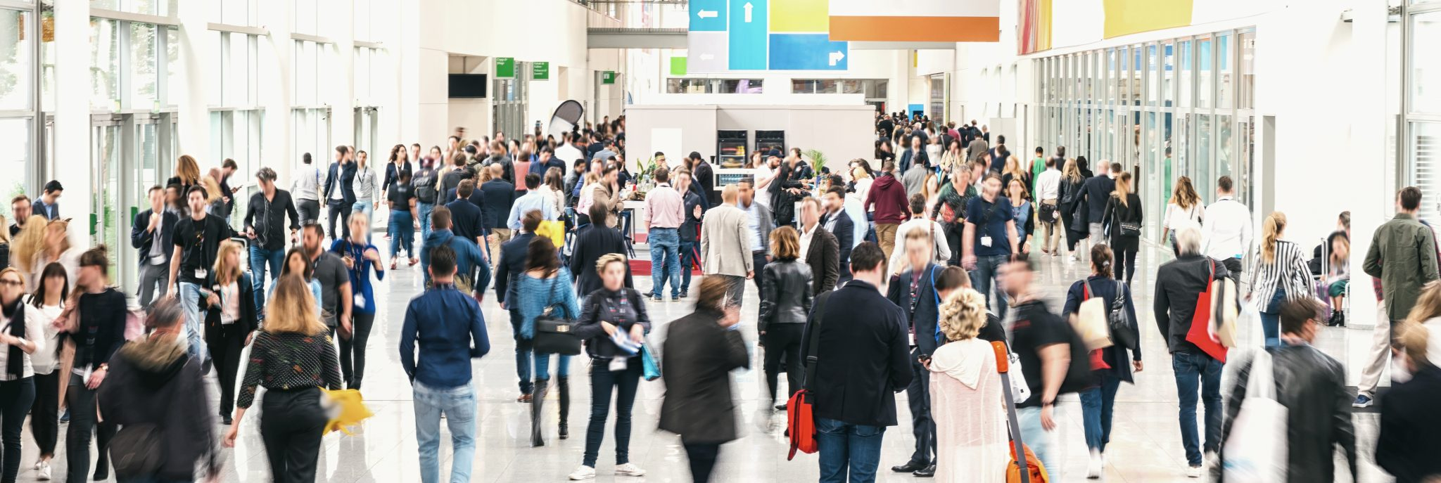 Exhibition hall with many people